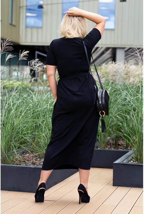 tył czarnej sukienki dekolt v
