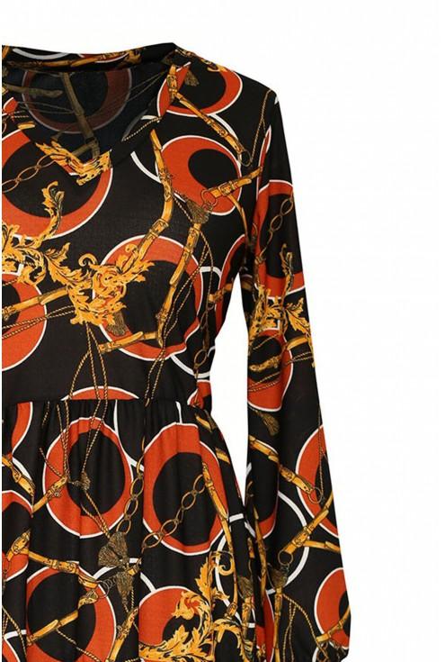 czarna sukienka z czerwono-złotym wzorem