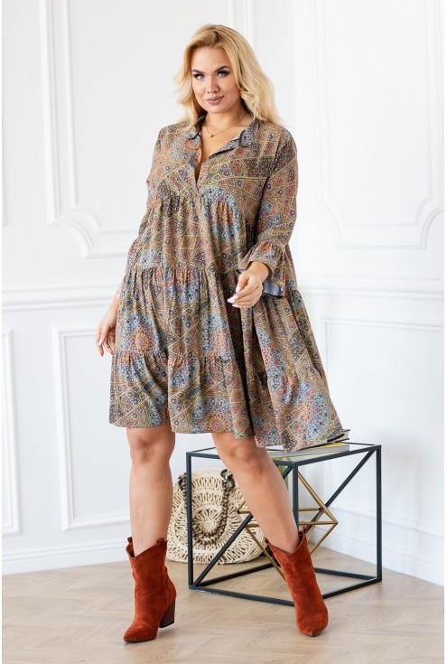 Kobieca zwiewna sukienka plus size błęboki dekolt