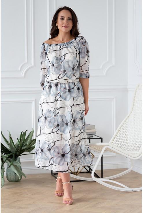 elegancka kobieca sukienka subtelne kwiaty