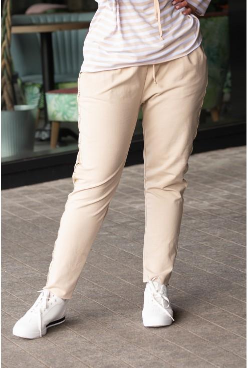 beżowe spodnie dresowe z lampasami w kolorze złota fashion