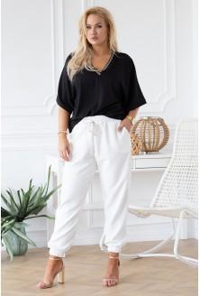 białe eleganckie spodnie plus size