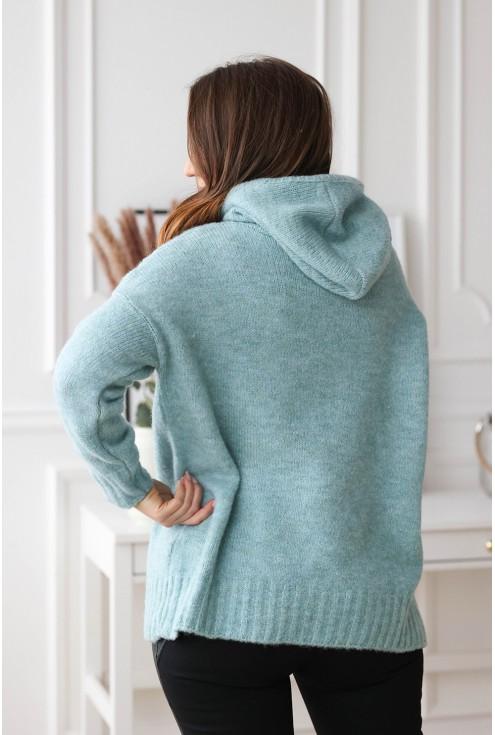 tył niebieskiego swetra plus size