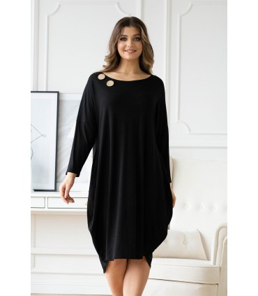 Czarna sukienka z ozdobnymi kółkami - Vogue