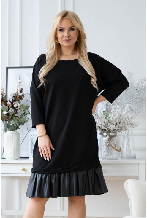 Czarna sukienka ze skórkową falbanką