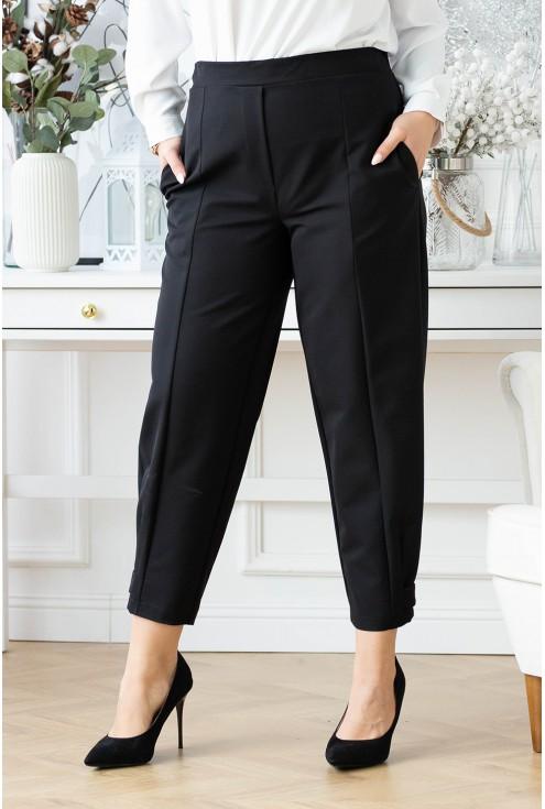 Czarne spodnie z zapięciem u dołu