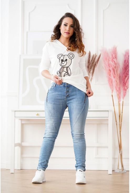 jeansy z suwakami na kieszeniach
