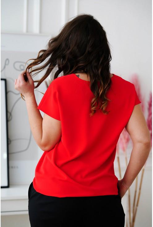 tył czerwonej bluzki Felipa