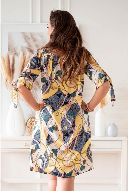 tył kremowo żółtej sukienki z dekoltem hiszpańskim plus size