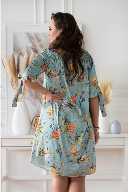 Tył seledynowej sukienki hiszpanka plus size