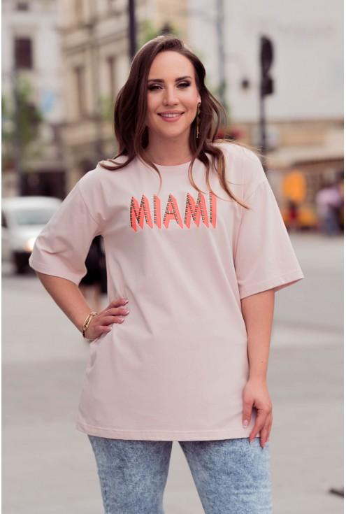 Pudrowa bluzka z pomarańczowym napisem xxl