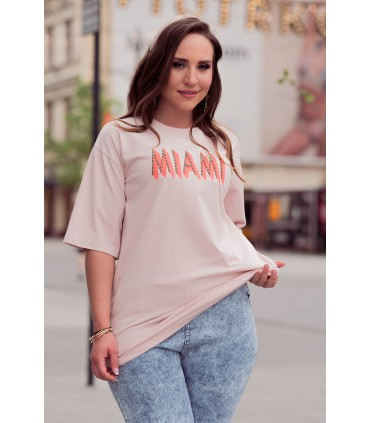 Pudrowa bluzka z pomarańczowym napisem - Salisa
