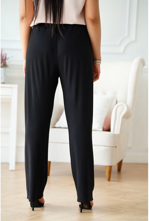 Czarne materiałowe spodnie plus size z szeroką nogawką z gumką w pasie