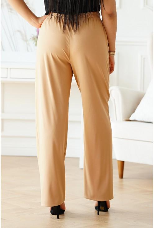 Beżowe spodnie z szeroką nogawką z gumką w pasie -xxl